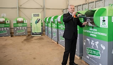 Director of ZEOS company mag. Emil Šehić is E-cycling, using street bins in Velenje, Slovenia